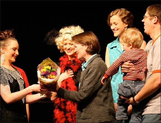 Here Bryan (holding little Mack) and I accept flowers from the cast after the show is finished.