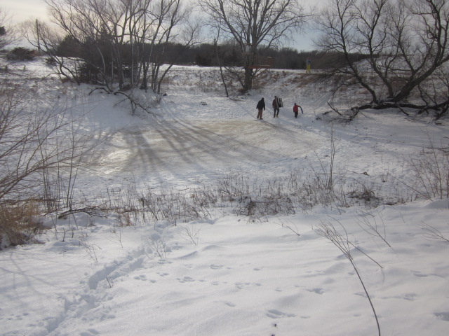Here's the best sledding spot on our place:  down the dam and across the pond.