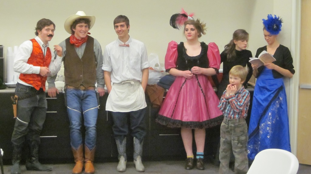 Here's a line-up of actors waiting to go onstage during rehearsal, and little Mack.