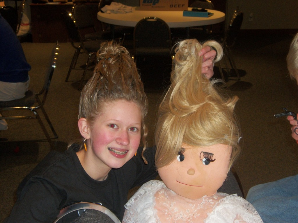 Even the dummy, Prunella, has big hair and is yukking it up with Amalia.