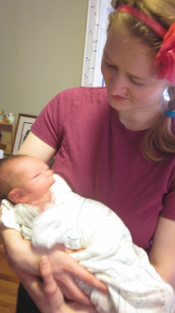 Aunt Bethie admires the cutest baby in the room.