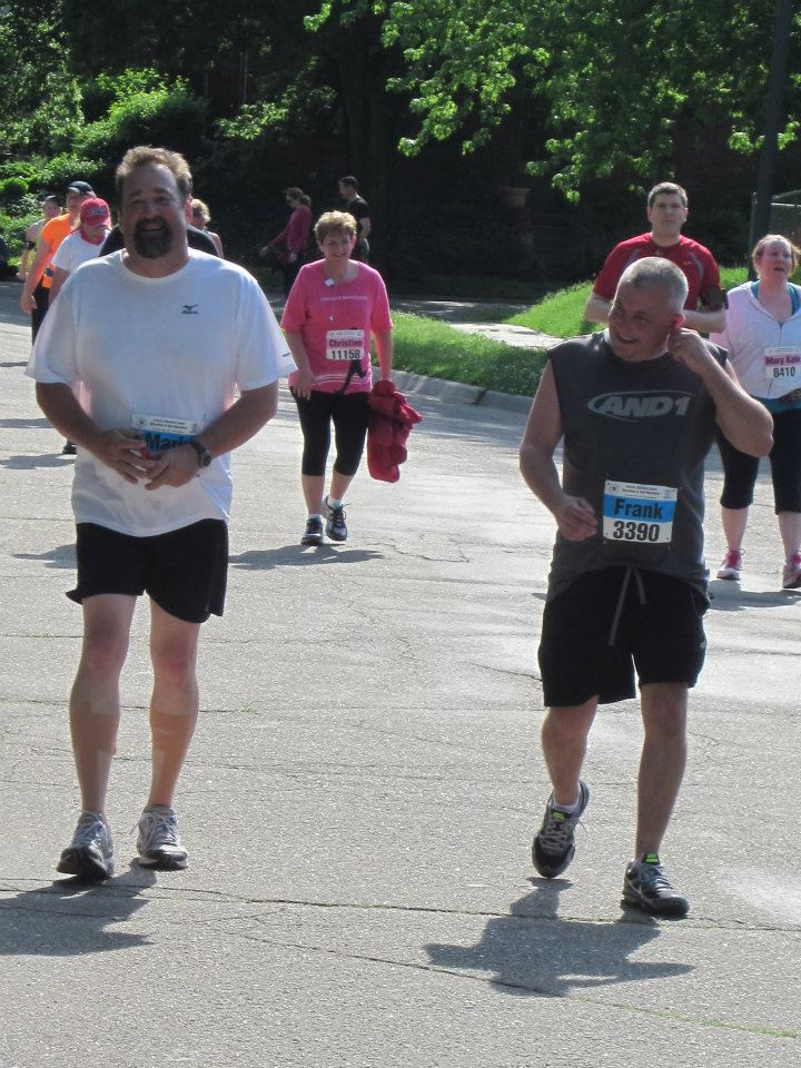 Here's my brother Mark running in the half-marathon.  He's the one on the left, with the cute legs.