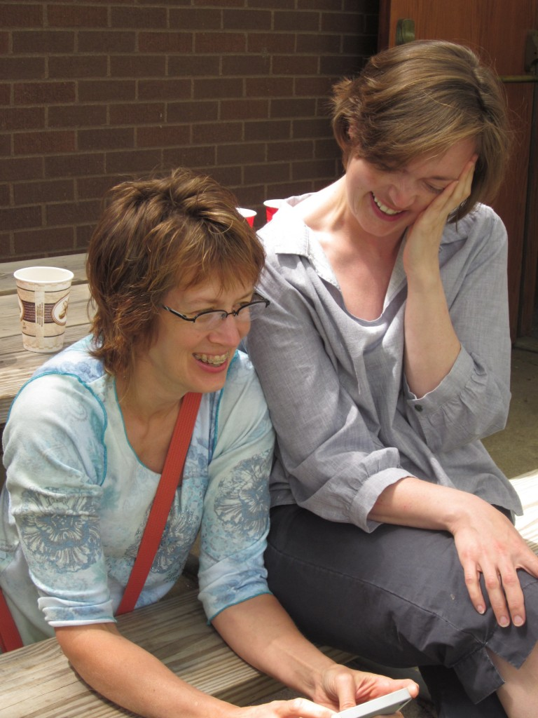I love this photo of my beautiful sisters giggling over something funny.