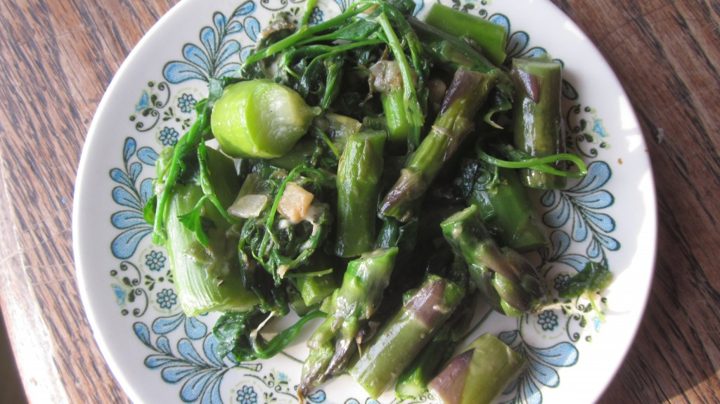 In this dish, I sauteed garlic and onion in a bit of olive oil, then added some chopped asparagus for a brief steaming, and then threw in a couple handfuls of lambsquarters and sauteed them briefly, until they were wilted.  Delicious!