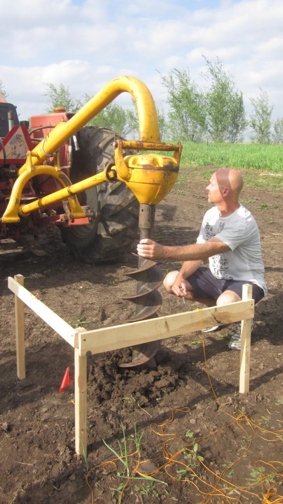 My brother-in-law Dave makes sure the drill goes into the ground at the proper angle, that is, not at an angle.