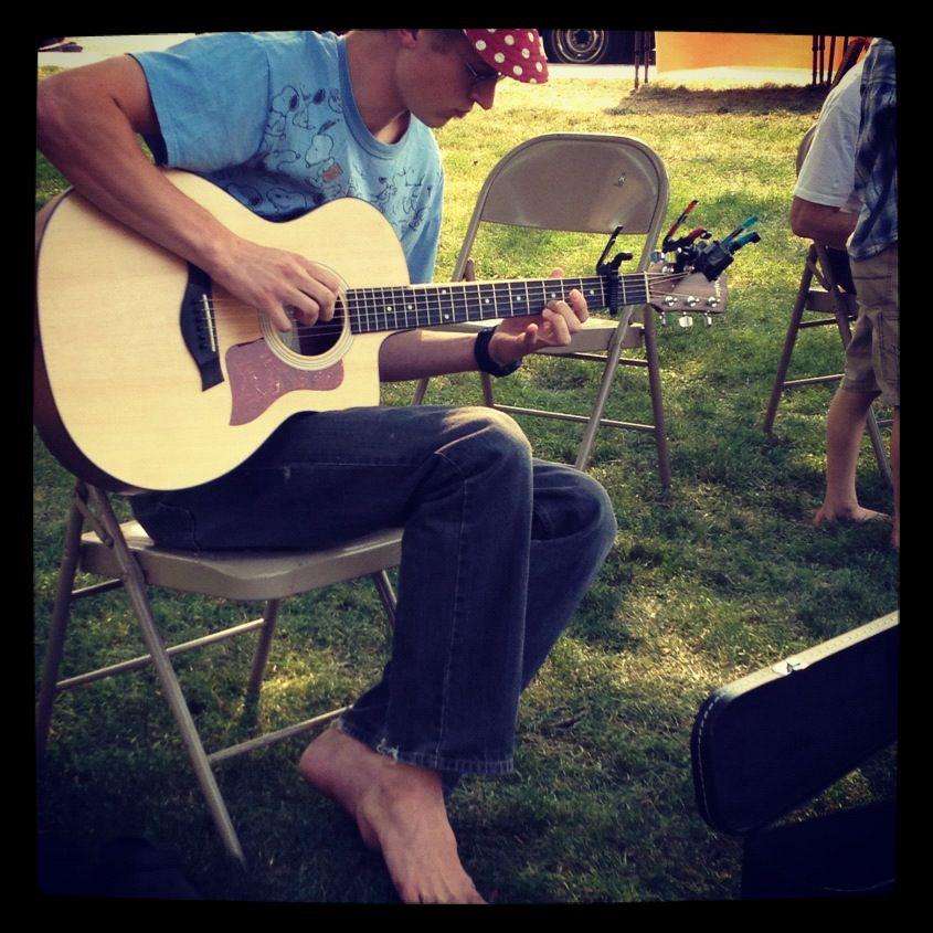 Here's Timothy playing his guitar at Farmer's Market.