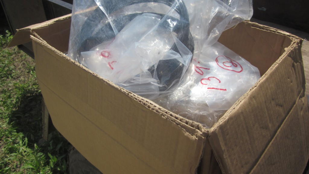 Hooray! The UPS man brought us our box full of missing bolts, screws, washers, and assorted bits, just in time.