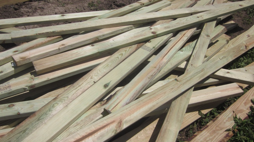 It takes a pile of wood to build the ends of the hoophouse.