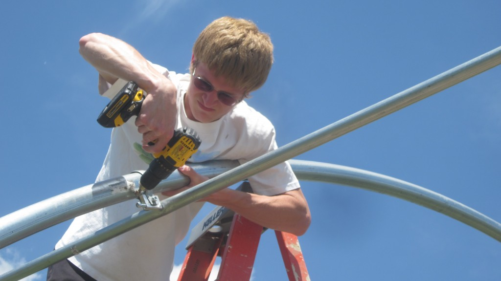 It took some effort to get the screws through the pipe, sometimes. Good thing Timothy's a strong farm boy.