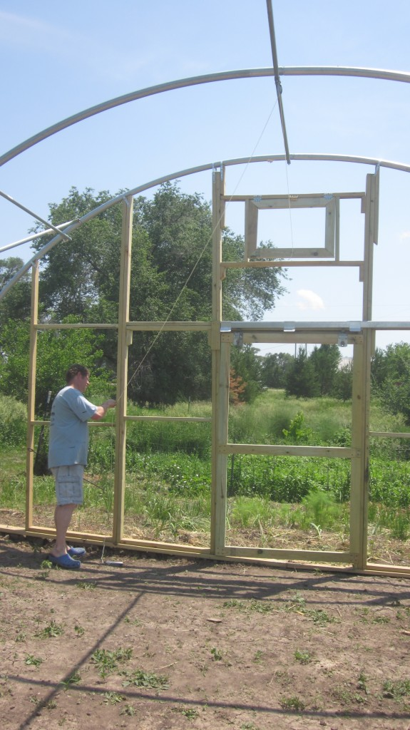 Here Bryan demonstrates the pulley system which will open the little window at the top that he has built, on very hot days.  I love this man.