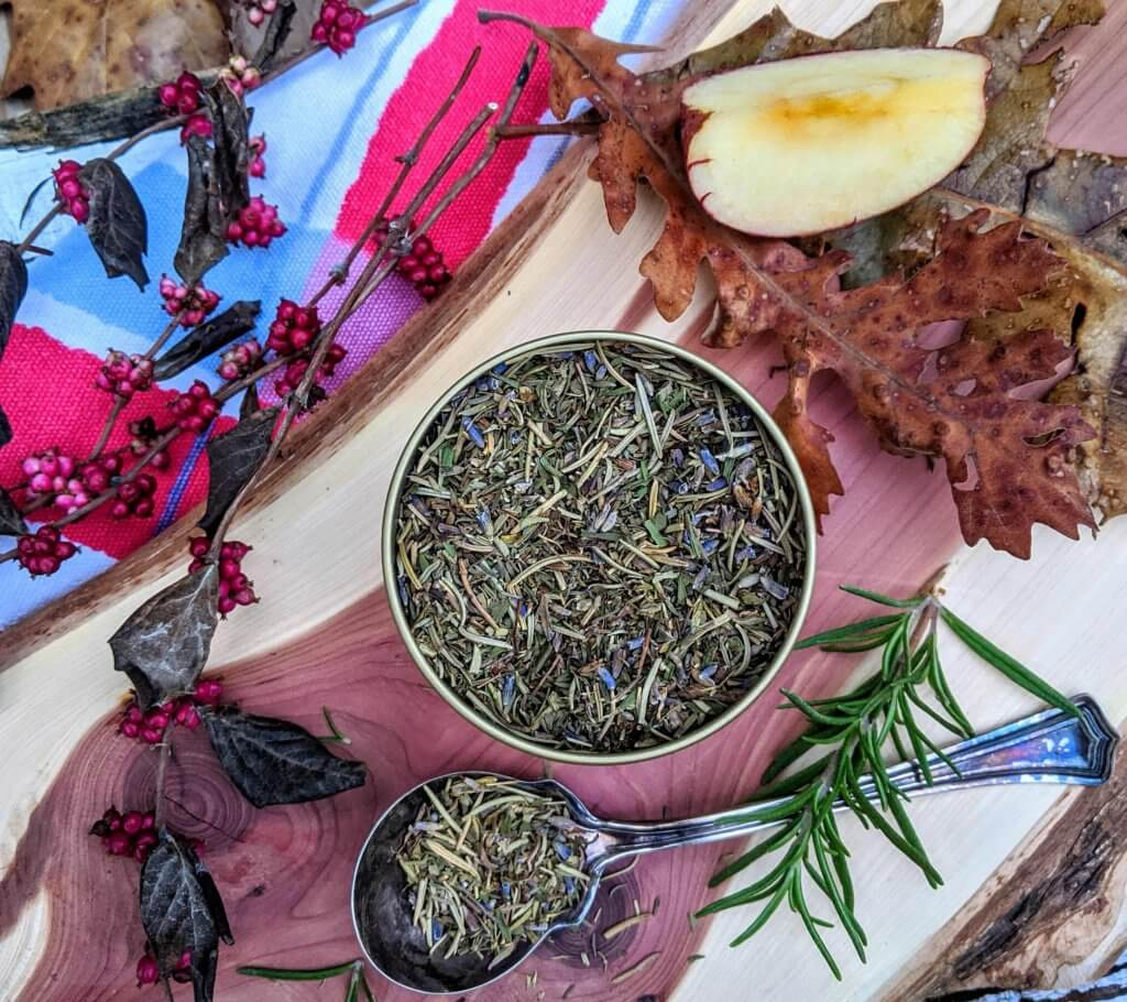 tin of dried herbs with fall leaves