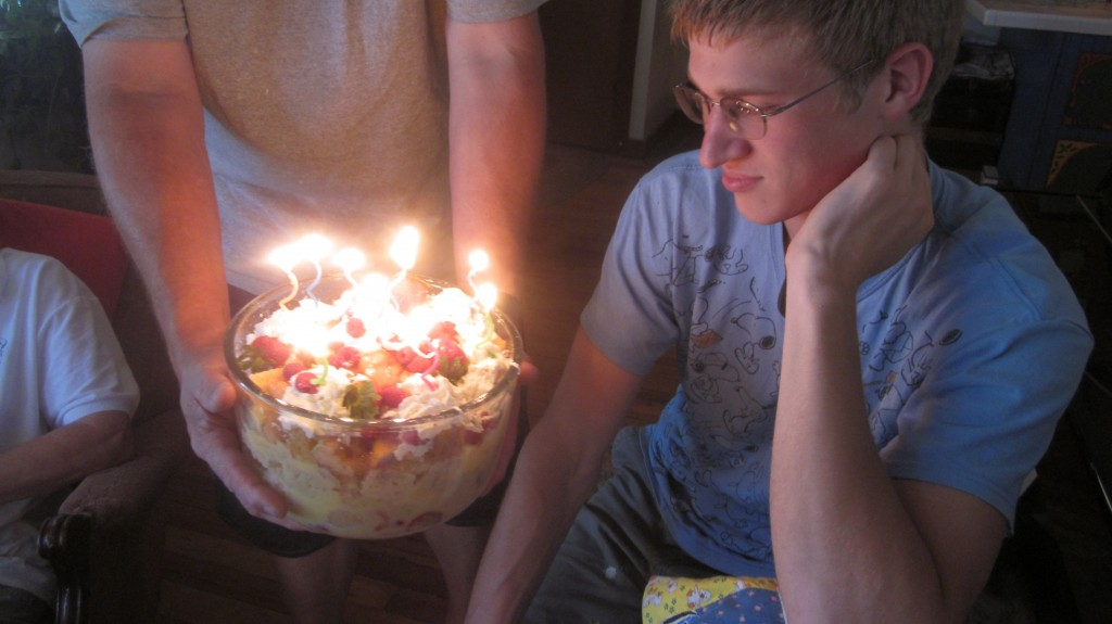 Timothy gazes at his birthday trifle.