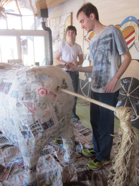 Here are two of my nephews, Luke and Davey, working on one of the horses.