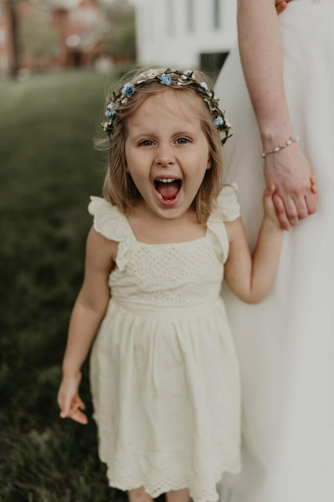 little flower girl with happy face