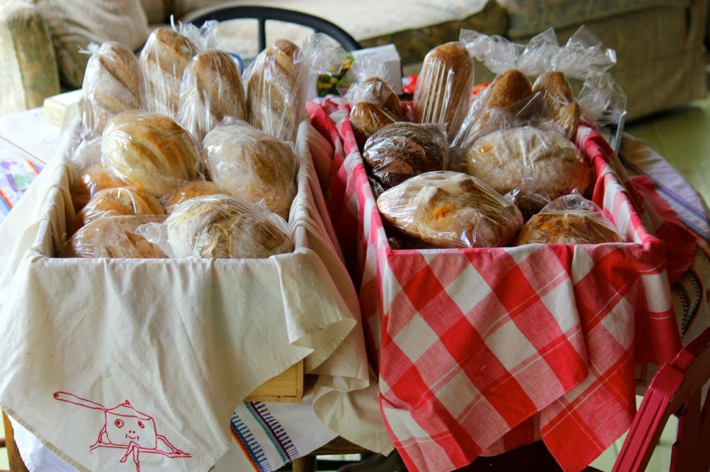 Here are my bread boxes, packed and ready for farmer's market. See the embroidery on the towel on the left? Cute, huh?