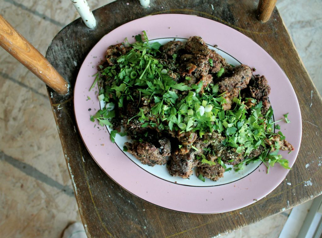 platter of chicken livers smothered in fresh herbs