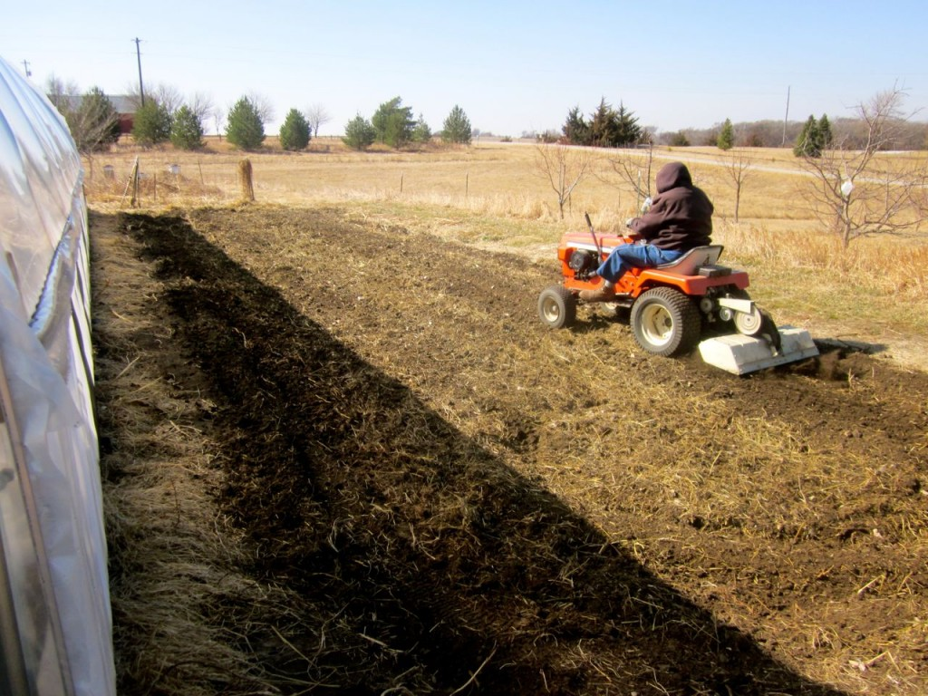 Familiar sight in the spring: Dad rototilling our gardens.