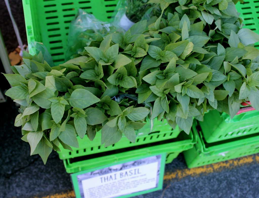 Bunches of Thai basil, nearly sold out.