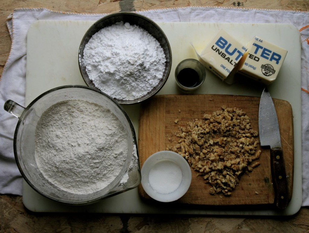 Precious few ingredients go into these simple cookies: powdered sugar, flour, vanilla, butter, salt, and toasted nuts.