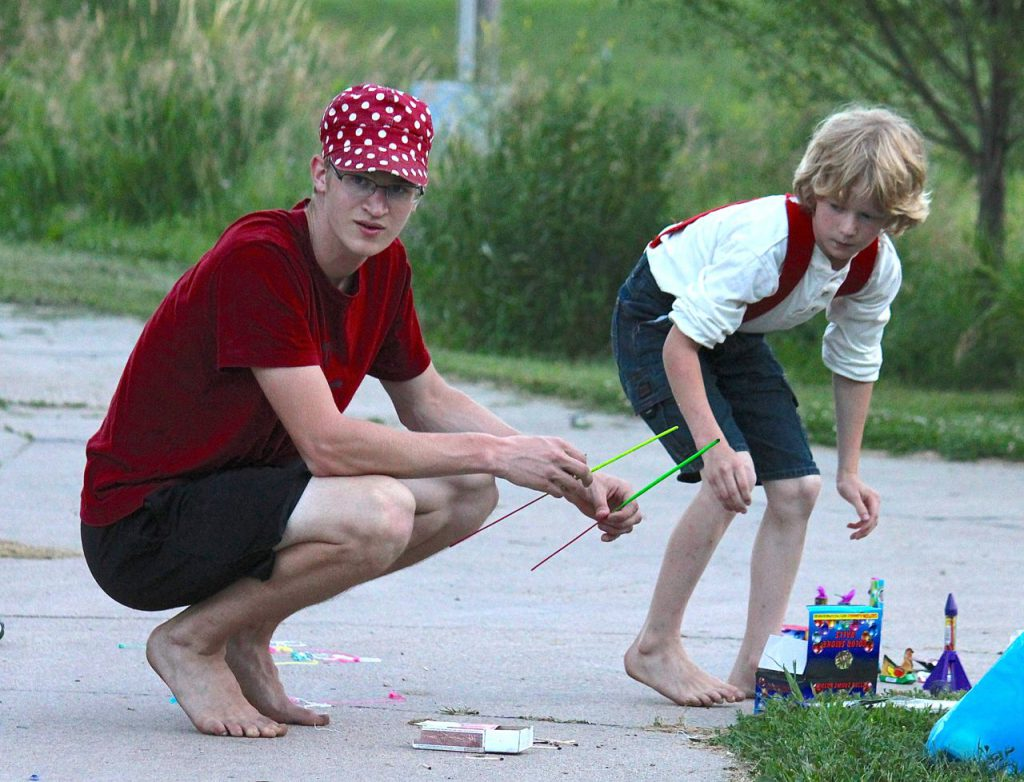 I love this picture from last Fourth of July, of Timothy and Mack shooting off fireworks. Please avert your eyes from their bare feet. Really. Who lets their boys shoot off fireworks with bare feet? *blushing*