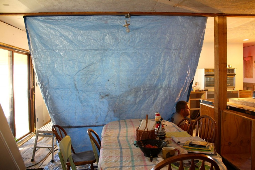 Reubsy put up this tarp ostensibly to keep the dust out of our living area, but I think it's really just because he wanted a bit of privacy.