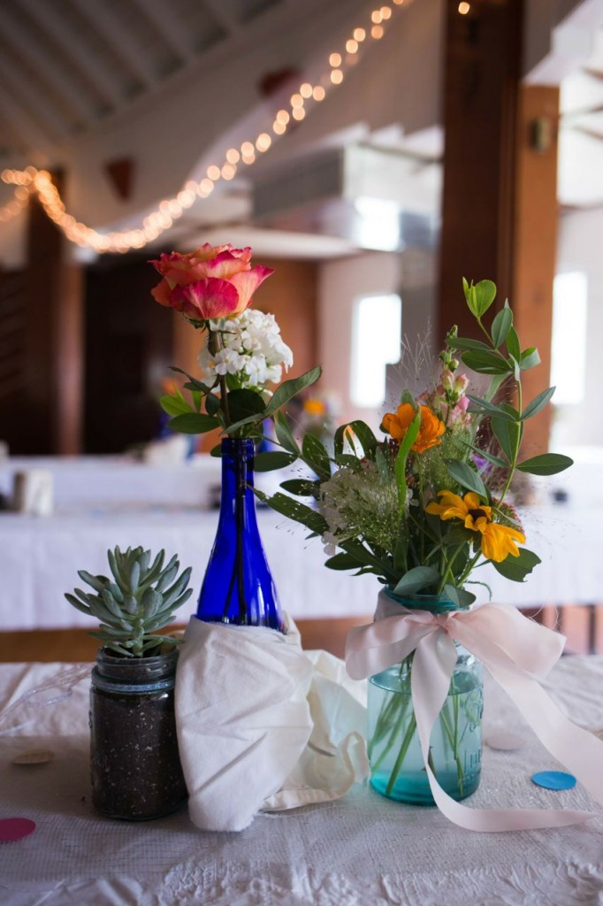 Succulents + white twinkle lights in abundance + fresh flowers + sloppy puddling ribbons + punched paper circles = Bethie's wedding style.