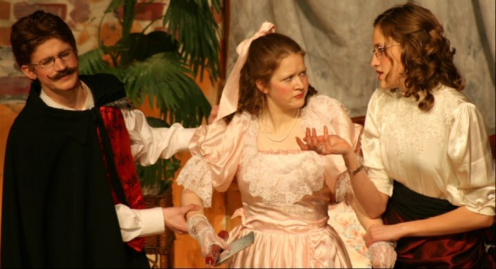 """Here Timothy Miller and Abi Wood have a tussle with Bethany Miller, in """"Holder Posey."""""""