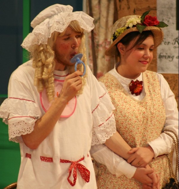 """Here Andrew Miller (as Baby Boo-Boo) and Larissa Miller (as Mother Sweetums) perform in """"Holder Posey."""""""
