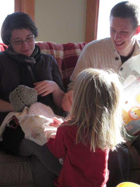 Matthew and Rachel with some new baby things, and cousin Sophia in the foreground.