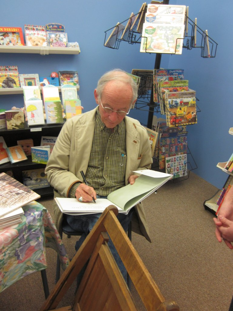 """Here he is, my BFF, signing copies of his new book """" """" at our local bookstore. I have such a crush on him, and he doesn't even know I exist."""