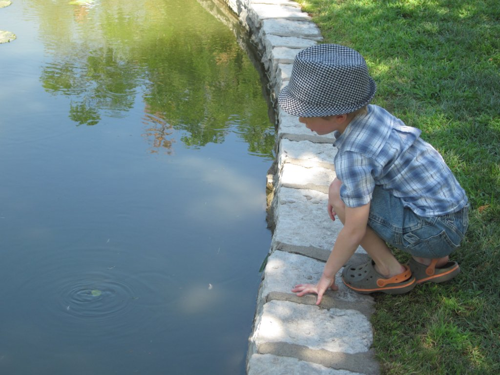 Here little Mack makes his mother nervous as he contemplates how far he can lean over the pool.
