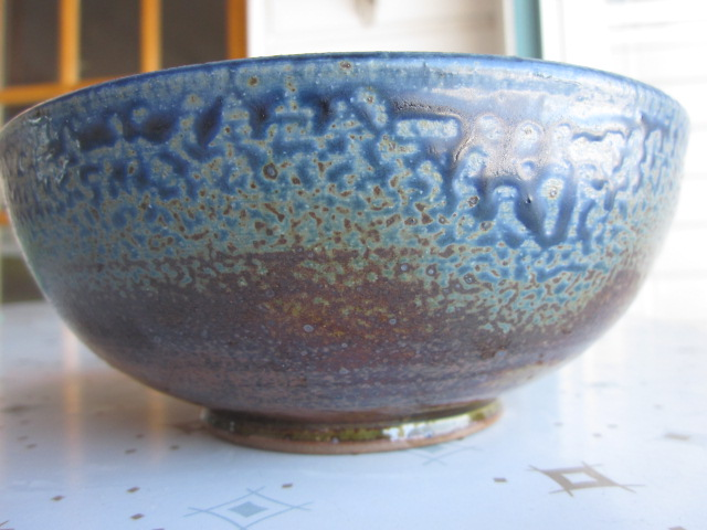 And here's the outside.  I love that crackly glaze.  I know there's a pottery-techie term for it.