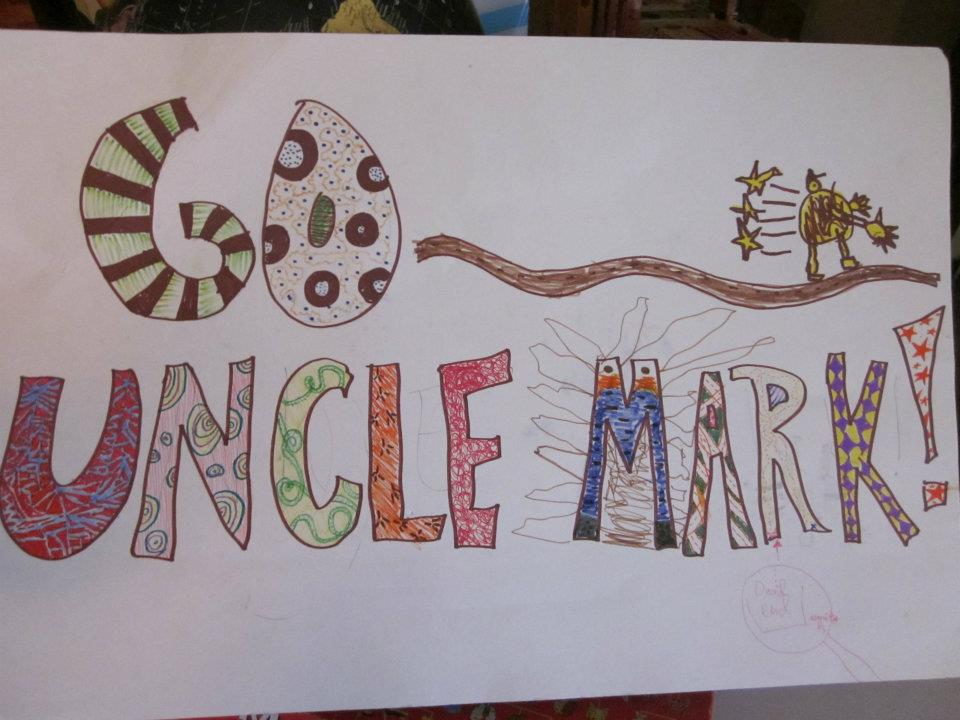 Little Mack drew this poster to encourage my brother Mark, who ran his first half-marathon in May.  (The little figure on the right is Mark.)