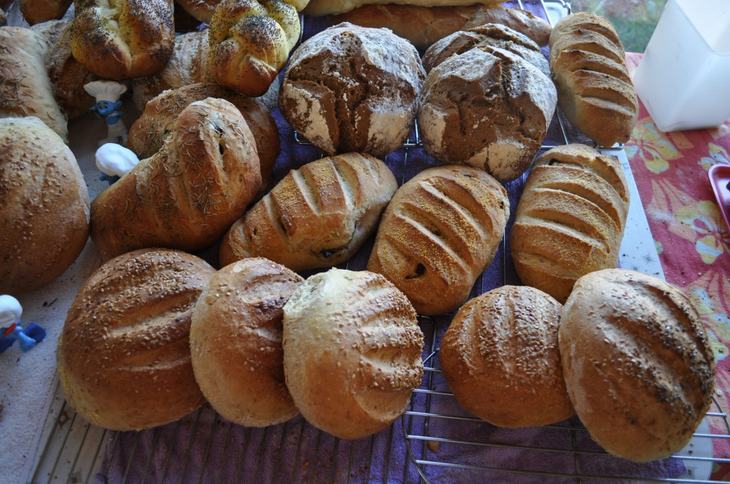 Here are a few batches of bread on Farmer's Market day last summer. Doesn't it make you happy just looking at them?