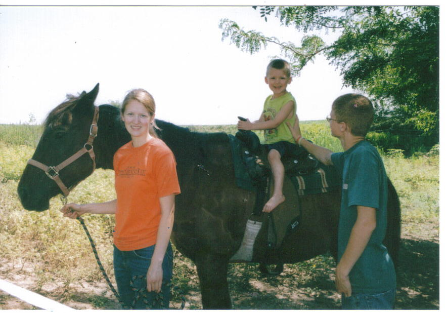 Bethie and Timothy here are taking their little cousin Orion for a ride on Romeo.