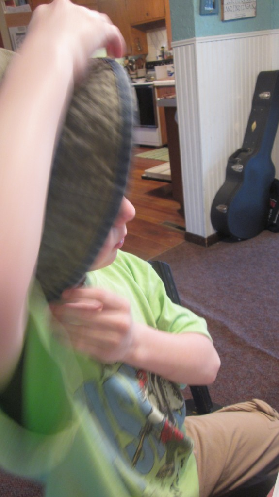 Little Mack tries to become invisible inside a hat.