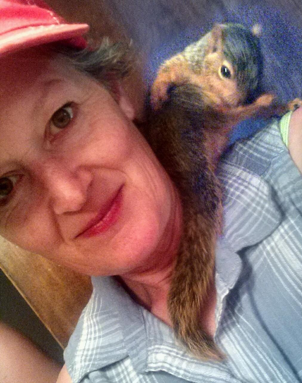 woman with squirrel on her shoulder