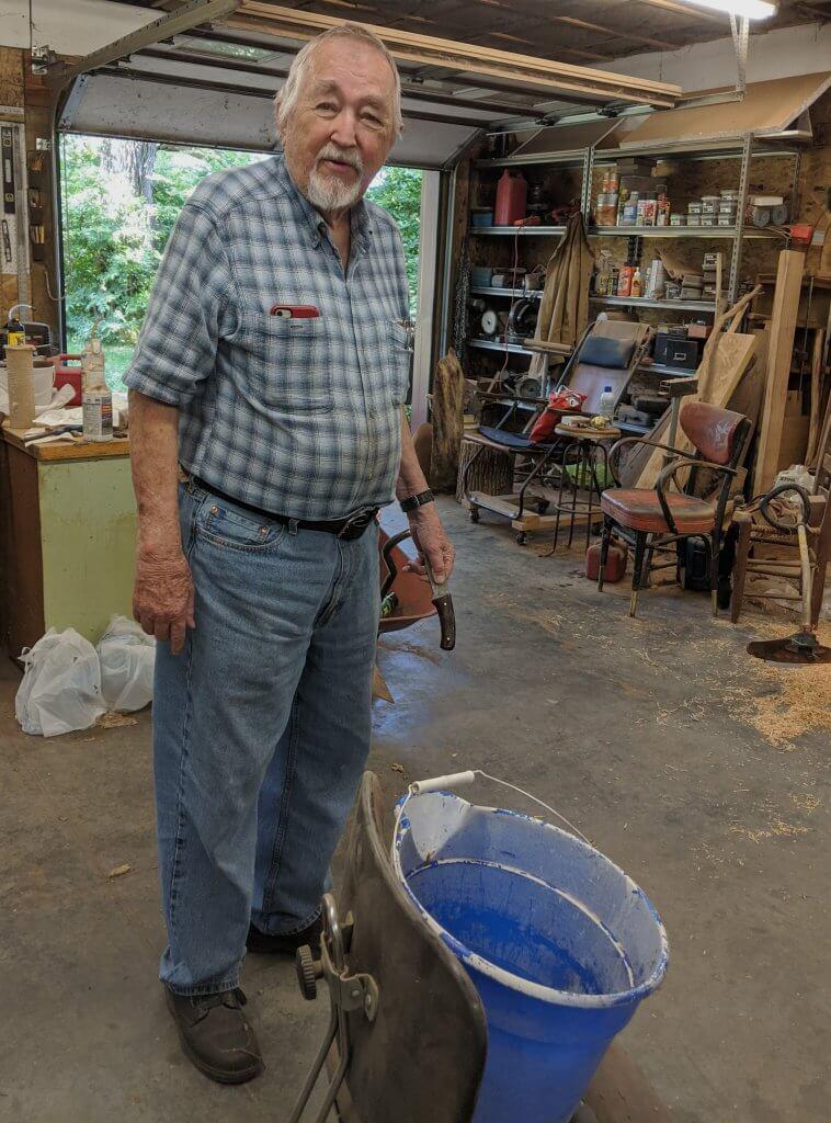 man standing in his workshop
