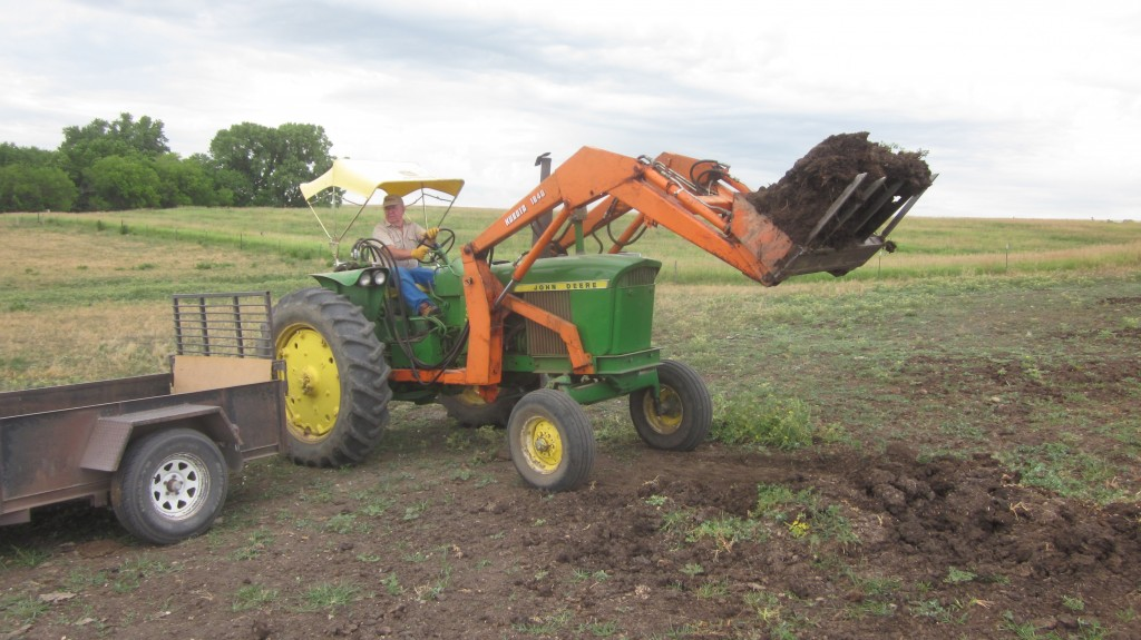 Gosh, it's nearly effortless, using that loader . . . I think I'm in love with a tractor.  Is that strange?