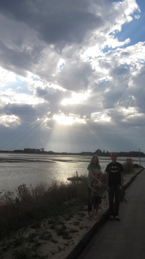 Some of my favorite people, my nephew Adam and little Mack and Amalia, in front of a startlingly lovely sunrise on the Missouri River,