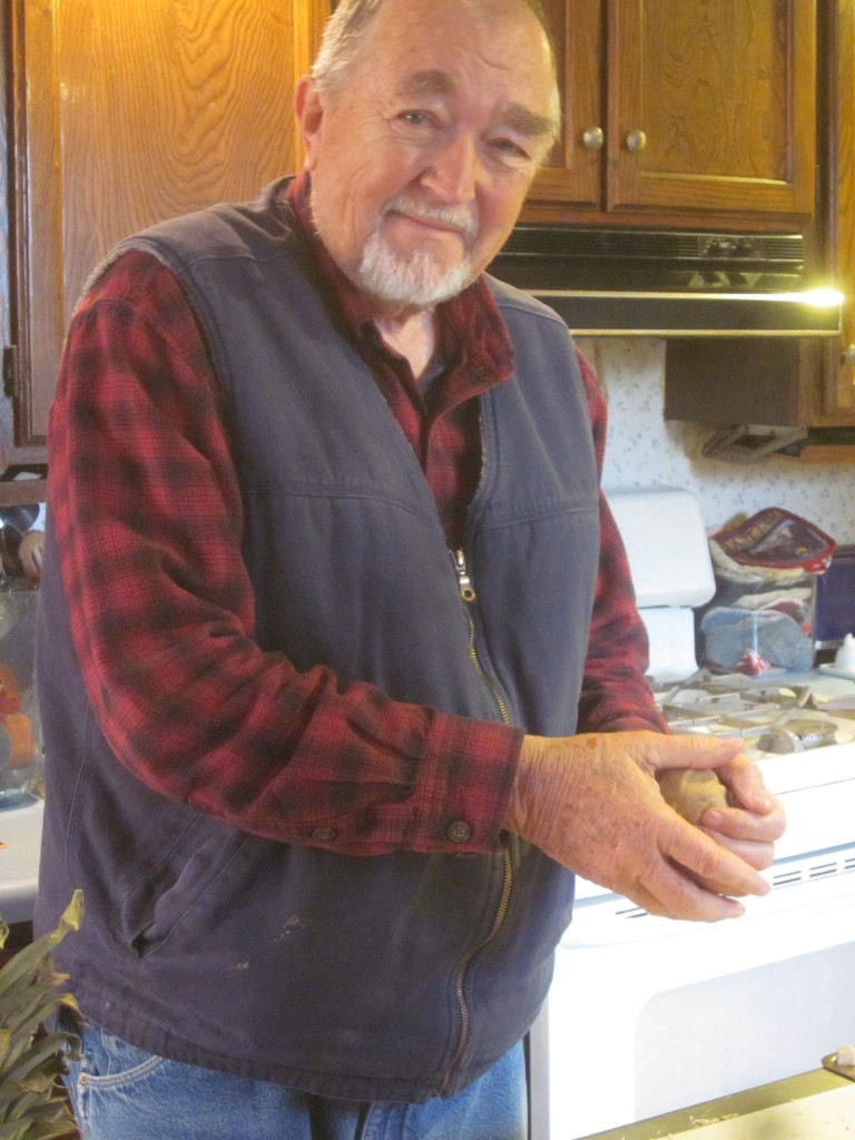 Here's my cute dad, with a ball of dough.