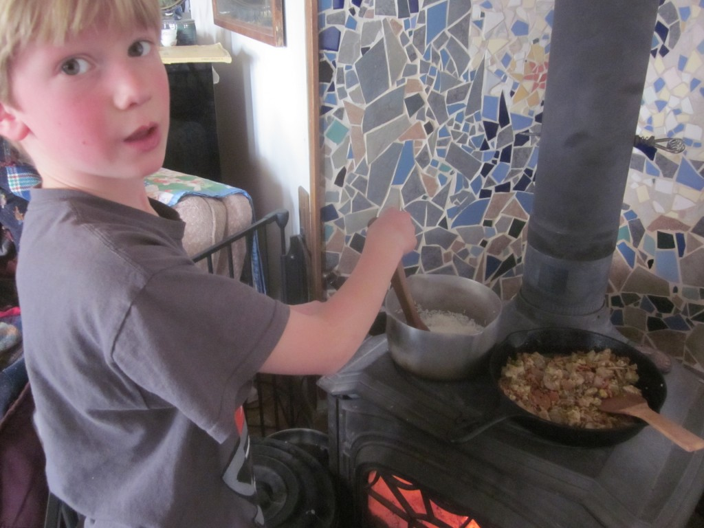 """Little Mack took his stirring responsibilities very seriously. """"Getting a little hot here, Mom . . . """""""