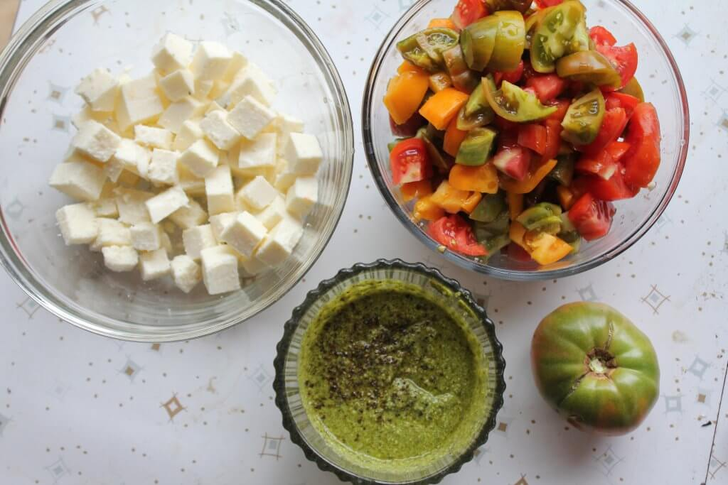 bowls of ingredients for chopped Caprese salad
