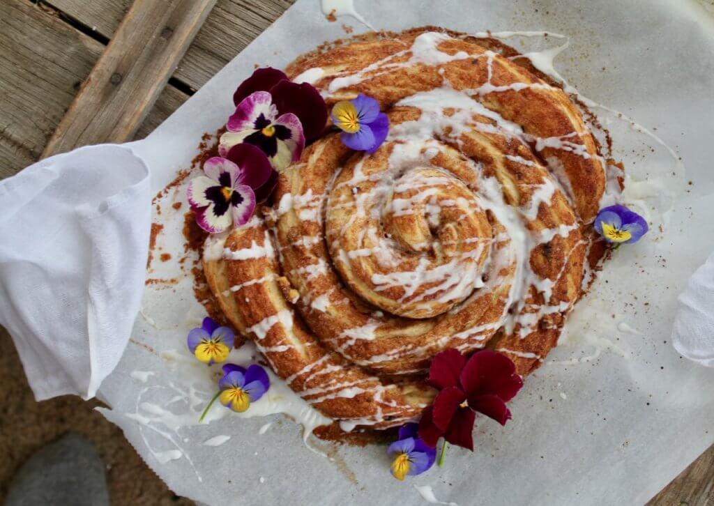 spiral of coffee cake with pansies