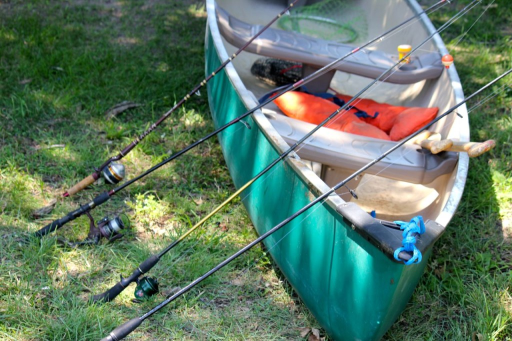 Rods and canoe all ready for catching a load of fish. Only. We only caught one. Well done, Bethie.