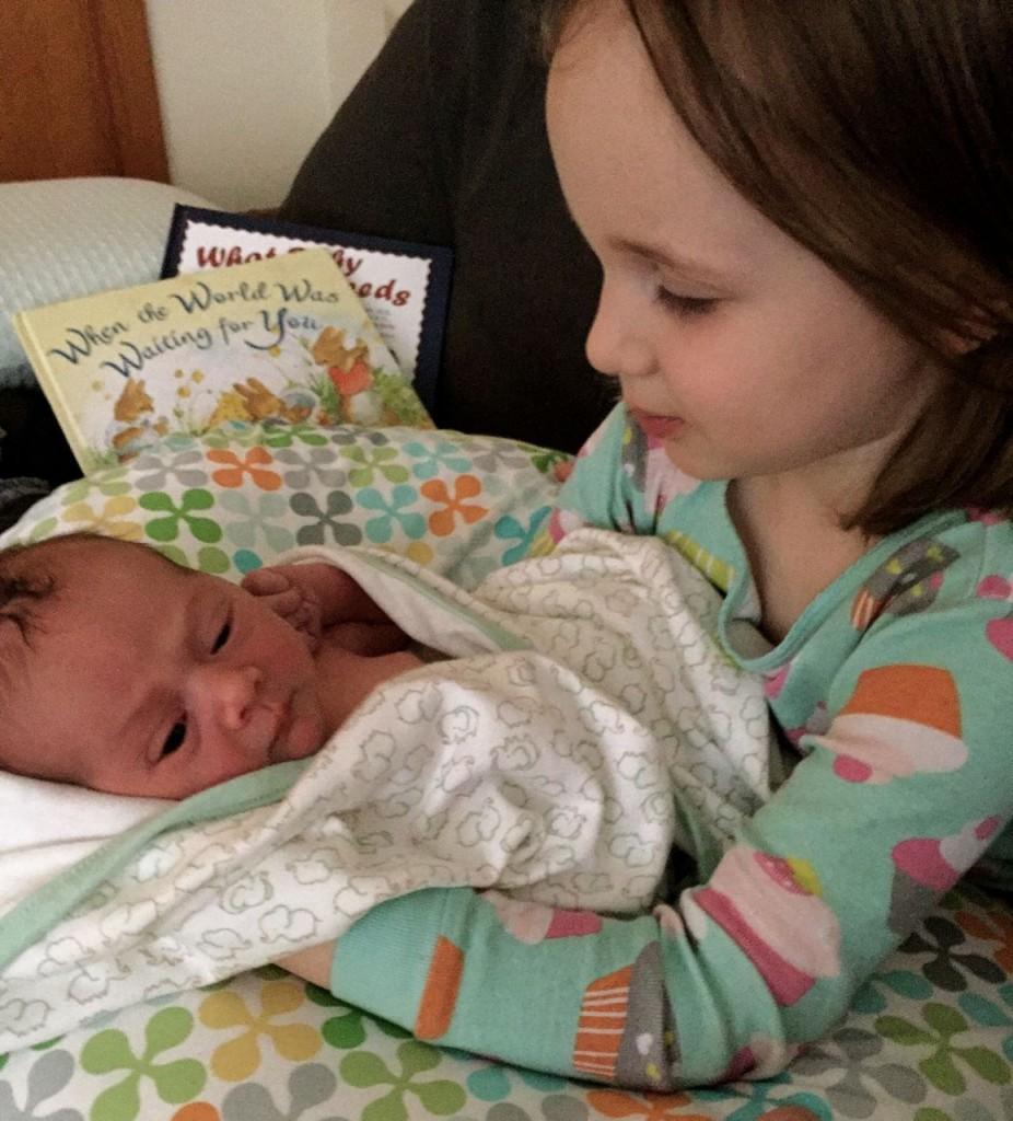 Anya meets her new baby sister Eleanor.