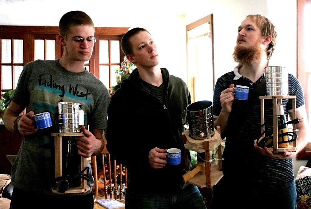 The guys in our family do have a weird obsession with roasting their own coffee beans. Here's proof of it: (from l to r) Timothy, Matthew, and Andrew posing with their new coffee roasters.