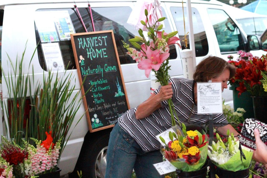 Here I am, pretending to be working on a bouquet, but actually trying to hide behind this little sign. It didn't work.