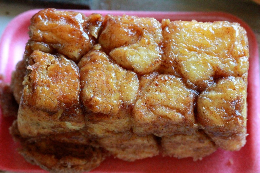 Everybody loves this caramel monkey bread and it is so easy: you just dip balls of dough into melted butter, and then cinnamon sugar, and then plop them in the pan.