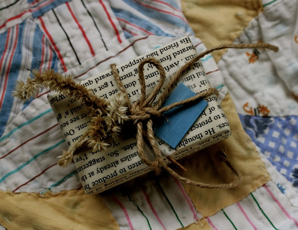 Another bitty box decorated with a single book page, a bit of twine, and a dried coxcomb.